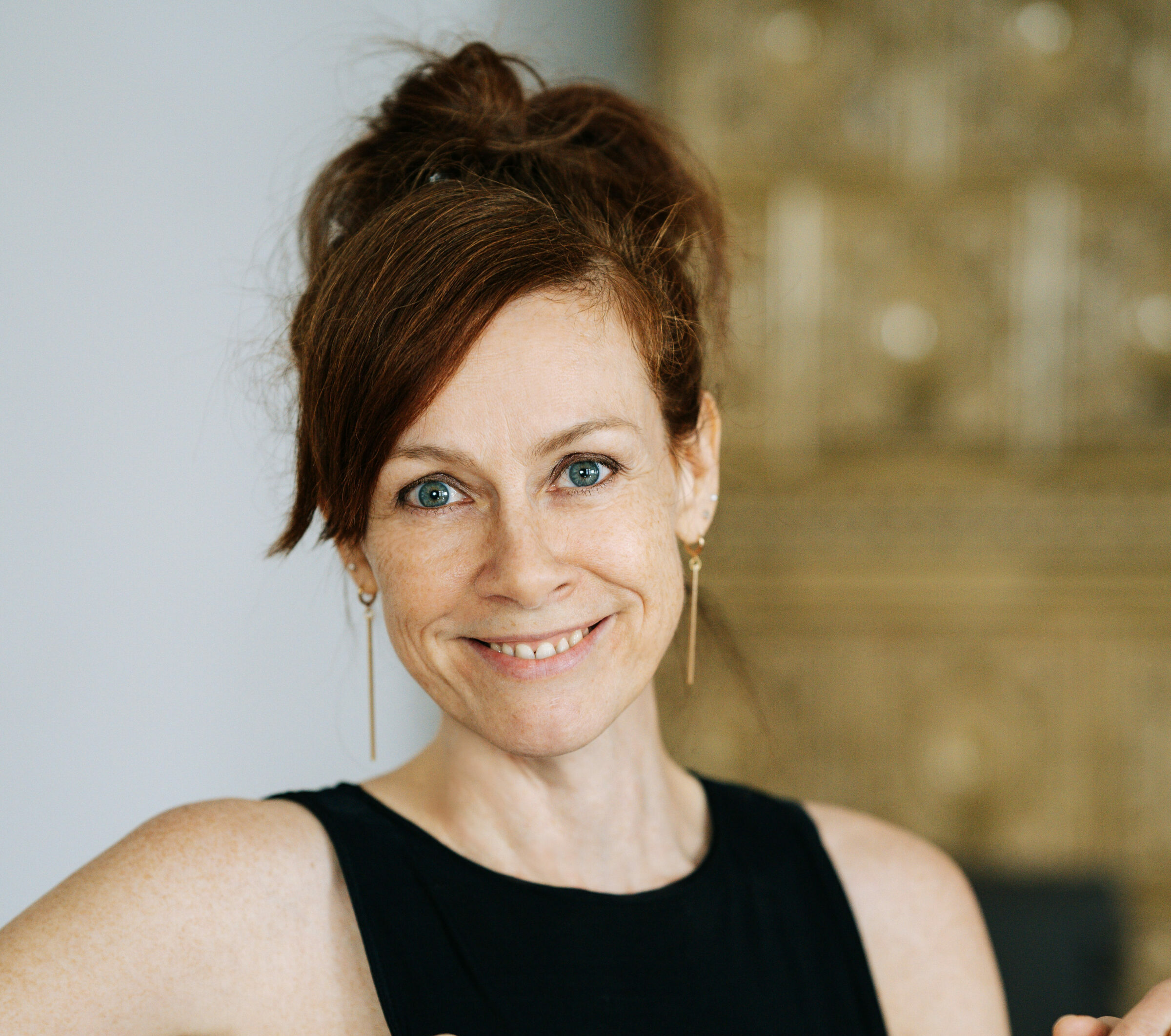 Portrait of Andrea Filseker - Vinyasa Flow and Yin Yoga teacher at RE:TREAT
