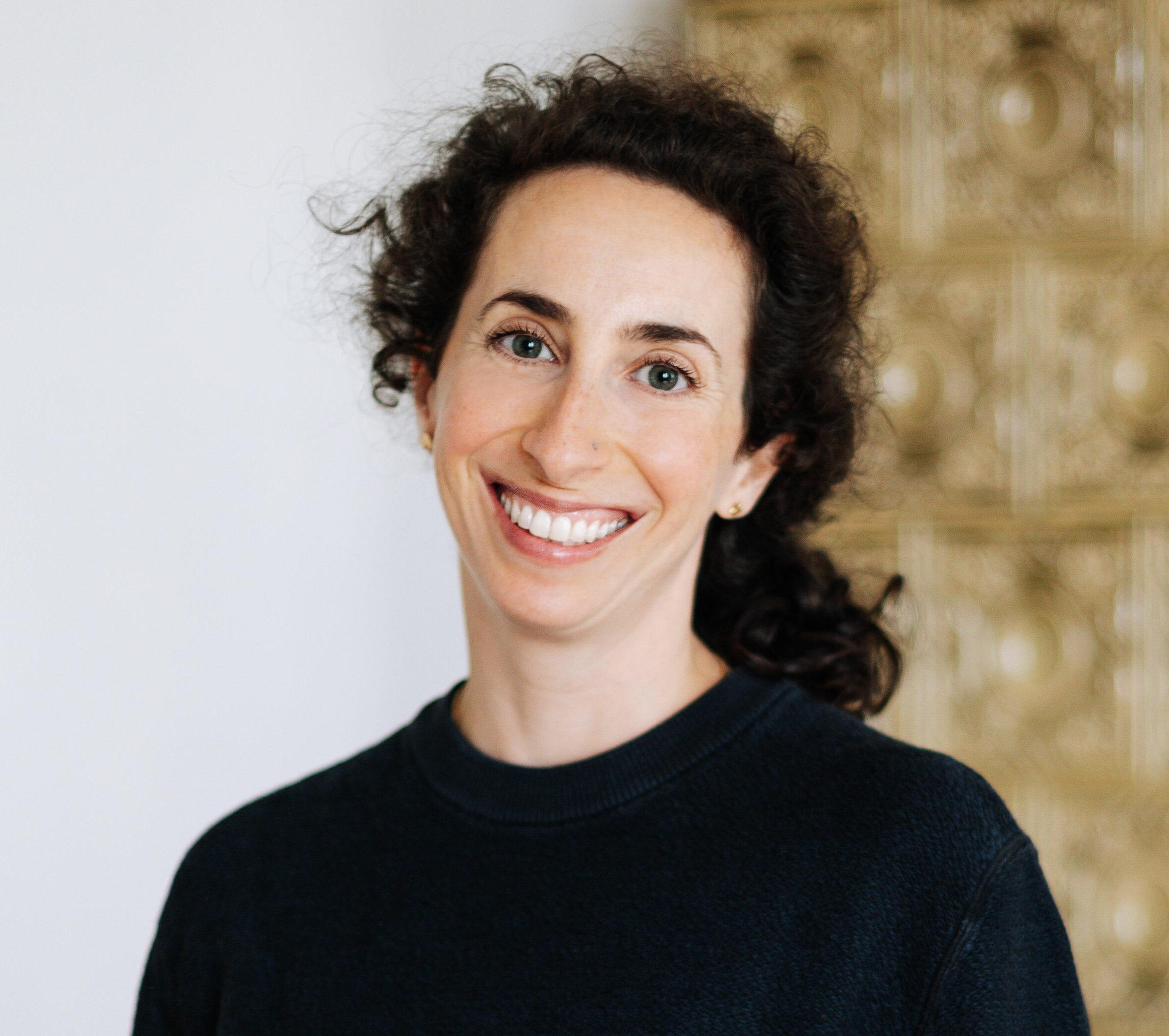 Portrait of Sarah Scharf - Flow & Restore Yoga teacher at RE:TREAT