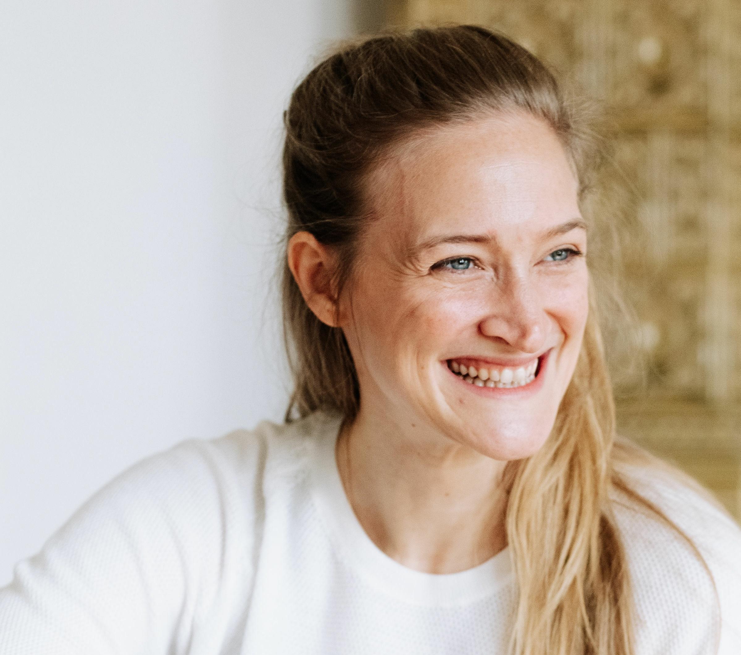 Portrait of Stefanie Grimm - Yin and Vinyasa Flow yoga teacher at RE:TREAT